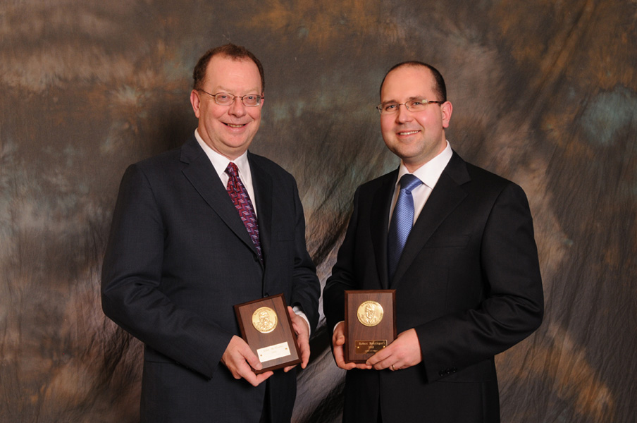 2010 - John McManus  and Robert Rotzinger The Association for Mineral Exploration British Columbia, E.A. Scholz Award