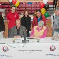 Russell Hallbauer, Taseko's CEO, and Chief Ann Louie, signing the Participation & Cooperation Agreement